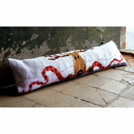 "Pop your stuffed tight into the other end of the draft excluder and sew the final open end together. Decorate however you like! Ribbons, glitter, buttons, ""Home Sweet Home"" patches – whatever will make you feel warm and fuzzy inside, while you're new draft excluder keeps you warm on the inside."